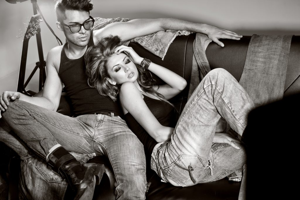 Sexy man and woman doing a fashion photo shoot in the studio