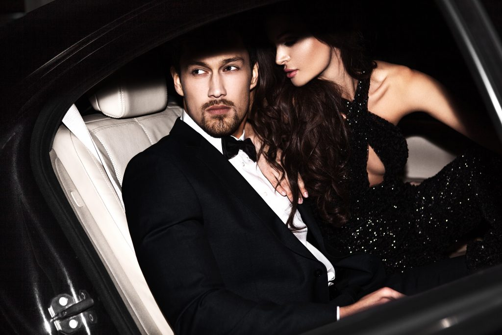 Sexy couple in the car. Hollywood stars.